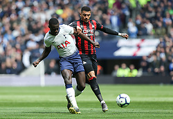 Davinson Sanchez of Tottenham Hotspur passes the ball under pressure from Karlan Grant of Huddersfield - Mandatory by-line: Arron Gent/JMP - 13/04/2019 - FOOTBALL - White Hart Lane - London, England - Tottenham Hotspur v Huddersfield Town - Premier League