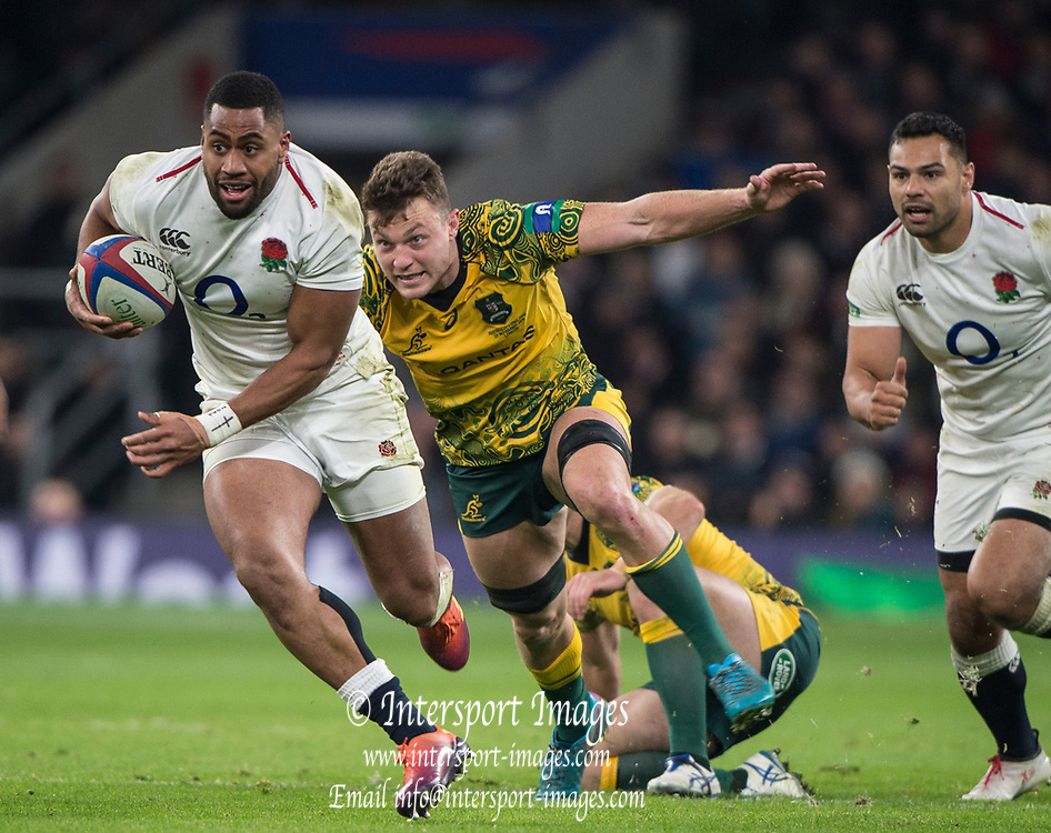 Twickenham, United Kingdom, Saturday, 24th  November 2018, RFU, Rugby, Stadium, England, Right, Joe COKANASIGA, running ith the ball as  Jack Dempsey, opens his arm for the grab tackle,  during  the Quilter Autumn International, England vs Australia, © Peter Spurrier