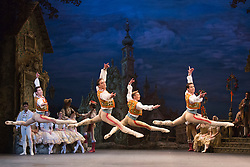 © Licensed to London News Pictures. 22/07/2014. London, England. Pictured: James Forbat, Guilherme Menezes, Vitor Menezes and Anton Lukovkin dancing. Working stage rehearsal of Coppélia with the English National Ballet at the London Coliseum. With Shiori Kase as Swanilda and Yonah Acosta as Franz. Choreography by Ronald Hynd after Marius Petipa to music by Léo Delibes. Music performance by the Orchestra of the English National Ballet conducted by Gavin Sutherland. Photo credit: Bettina Strenske/LNP