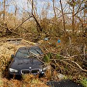 MARATHON, FL - SEPTEMBER 16: <br /> A BMW vehicle amid debris in Big Pine Key  on September 16, 2017 in Marathon, Florida.  (Photo by Angel Valentin/Getty Images)