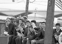95322<br /> <br /> American President John Fitzgerald Kennedy (J.F.K.)'s visit to Ireland June 1963.<br /> Young folk with American flags.<br /> (Part of the Independent Newspapers Ireland/NLI collection.)