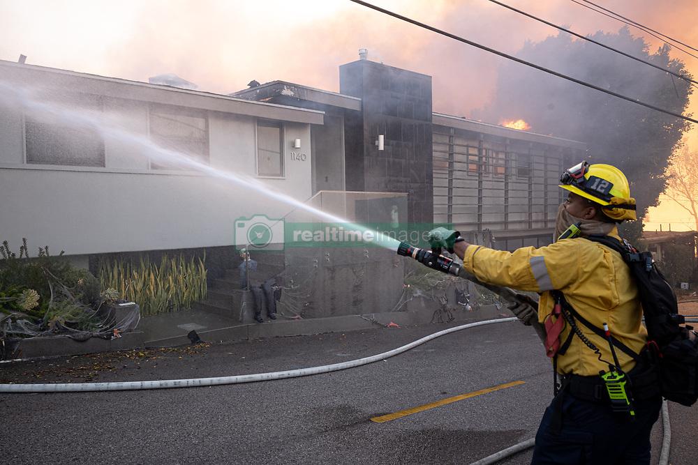 October 28, 2019, Los Angeles, California, USA: Firefighters put water on a burning home along Trailridge in Los Angeles in the Getty fire Monday, October 28, 2019. (Credit Image: © David Crane/Orange County Register via ZUMA Wire)