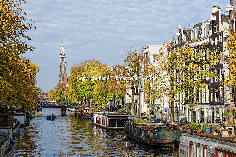 View on the Westertoren along the canals of Amsterdam, the Netherlands.