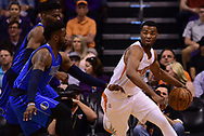 Apr 9, 2017; Phoenix, AZ, USA; Phoenix Suns forward TJ Warren (12) handles the ball against Dallas Mavericks defense in the first half of the NBA game at Talking Stick Resort Arena. Mandatory Credit: Jennifer Stewart-USA TODAY Sports