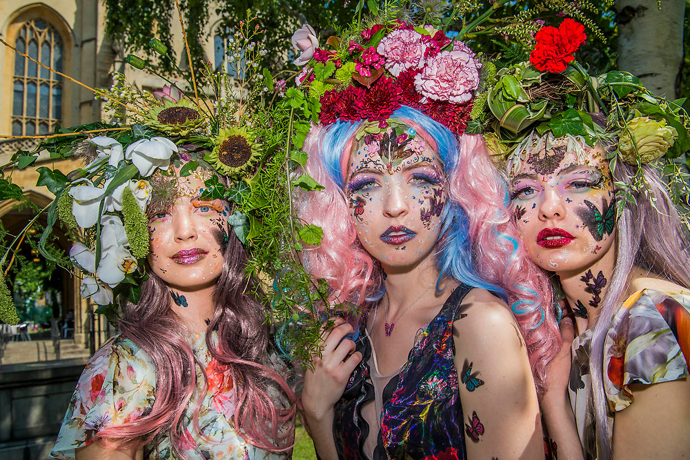 British couturier to royalty, Catherine Walker & Co. stages a showcase of its designs to pay tribute to the RHS Chelsea Flower Show and celebrate its 40th anniversary. Models were dressed in Spring Summer couture, complemented by floral and butterfly head dresses and make-up.   A ruby butterfly pendant to mark 40 years was also revealed. Carole Middleton wore Catherine Walker & Co at the wedding of her daughter Pippa on Saturday (and at the Royal Wedding of the Duke and Duchess of Cambridge) and over half of the dresses on display at Kensington Palace's Diana: Her Fashion Story are by the House.<br /> St Lukes Church, Chelsea, London 25th May 2017.