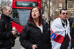 PLACE, January 14 2018. A few dozen protesters from 'The People's Charter' group demonstrate outside Downing Street demanding that the Brexit referendum result is respected following calls for a second referendum. PICTURED: A member of the protest hurls abuse at a cyclist after members attending the protest had stolen his flag from him. © Paul Davey