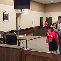 ADAs Mandana Shousthari, front right, and Brandon Vigil, back, begin to leave the courtroom after their victory in the Deborah Green trial which was held at the Thirteenth Judicial District Court Wednesday afternoon in Grants.