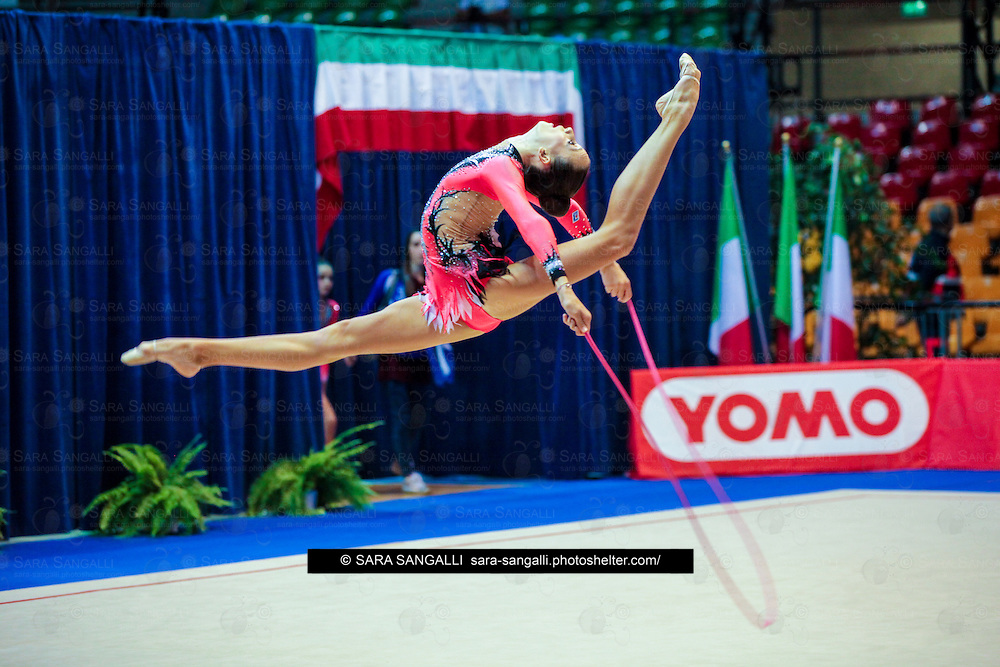 DESIO, ITALY - OCTOBER 31 2015: Alice Intini<br />  of Etruria performs with rope at the italian national rhythmic gymnastic championship. Her score in the apparatus is 14,300. Her team's score is 82,550 and ended up in sixth<br />  position.