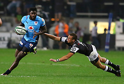 Curwin Bosch of the Sharks tackles Jamba Ulengo of th eBulls during the Currie Cup match between the The Sharks and The Blue Bulls held at King's Park, Durban, South Africa on the 27th August 2016<br /> <br /> Photo by:   Anesh Debiky / Real Time Images