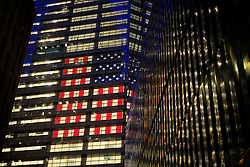 USA NEW YORK JUN10 - American flag on display behind a giant glass facade in downtown Manhattan, New York...jre/Photo by Jiri Rezac..© Jiri Rezac 2010