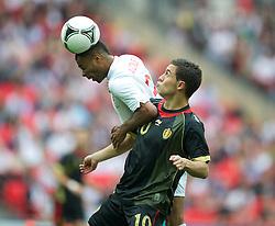 LONDON, ENGLAND - Saturday, June 2, 2012: England's Glen Johnson in action against Belgium's Eden Hazard during the International Friendly match at Wembley. (Pic by David Rawcliffe/Propaganda)