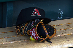 SAN FRANCISCO, CA - APRIL 20: Detailed view of an Arizona Diamondbacks baseball hat and Rawlings glove in the dugout before the game against the San Francisco Giants at AT&T Park on April 20, 2016 in San Francisco, California. The Arizona Diamondbacks defeated the San Francisco Giants 2-1. (Photo by Jason O. Watson/Getty Images) *** Local Caption ***