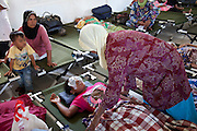 "June 2011 Cataract Operation in P. Sidempuan and Medan, Indonesia . Photographs by Michael Amendolia . Story researched by Susilawaty.The Story of Maslia and Nurasni LubisMaslia Lubis 15 and her sister Nurasni 19 are from jalan Sibolga, Desa (village) Sipenggeng in Batang Toru, 26kms from Padang sidempuan in North Sumatra,They were bilateral blind, means blind in both eyes. Cause of their blindness is cataract, a disease curable by an eight-minute operation. Yet Maslia had been blind since she was 3, and Nurasni since 5.Maslia's poor vision was noticed by her parents when she a toddler, she could not find toys she was playing with after they were dropped.Even with her impaired vision, Maslia is determined to continue studying and is a smart student. She is in secondary 3 (SMP 3), and although she can't see or write, she can hear and speak. She managed to be ranked 3rd in her class on her academic results.But it is difficult for her to enjoy school activities. She can't participate in sports. And she can't go to school on her own. She needs school mates' help.Maslia was always hopeful to regain her sight and often asked her parents to take her to clinics. But all the clinics they'd been could not cure her.Her parents (Sari Alam and Mara Aman Lubis), who rely on farming income from a quarter hectare land to feed a family of 6, could not afford to keep on spending on experimental treatment.Whilst Maslia is a confident and hopeful young girl, Nurasni has become the opposite.Constant teasing by friends calling her ""blind girl"" and inability to keep up with school her led to a low self-esteemed. Nurasni eventually dropped out of school after Primary 5 (SD 5). She had also somehow, accepting her fate. She never asked her parents to take her to clinics.Dr. Sanduk Ruit of Tilganga Institute of Ophthalmology - Nepal, operated both girls on The 16th June 2011 at the Military Hospital in Padang Sidempuan.Their vision was restored the very next day.Visiting the market and buying"