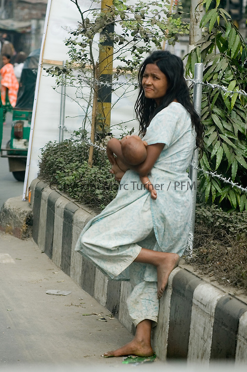 Women and children frequently Begging on the city streets.<br /> <br /> Amroa Manush, Pavement Dwellers.<br /> Concern Worldwide <br /> <br /> The city of Dhaka, Bangladesh.