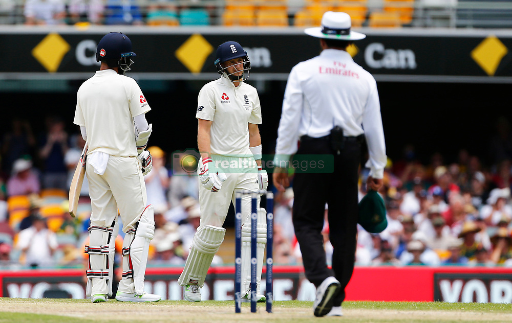 England's Joe Root walks off after being dismissed during day four of the Ashes Test match at The Gabba, Brisbane.
