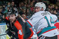 KELOWNA, CANADA - JANUARY 23: Rourke Chartier #14 of Kelowna Rockets checks Ty Stanton #4 of Medicine Hat Tigers on January 23, 2016 at Prospera Place in Kelowna, British Columbia, Canada.  (Photo by Marissa Baecker/Shoot the Breeze)  *** Local Caption *** Rourke Chartier; Ty Stanton;