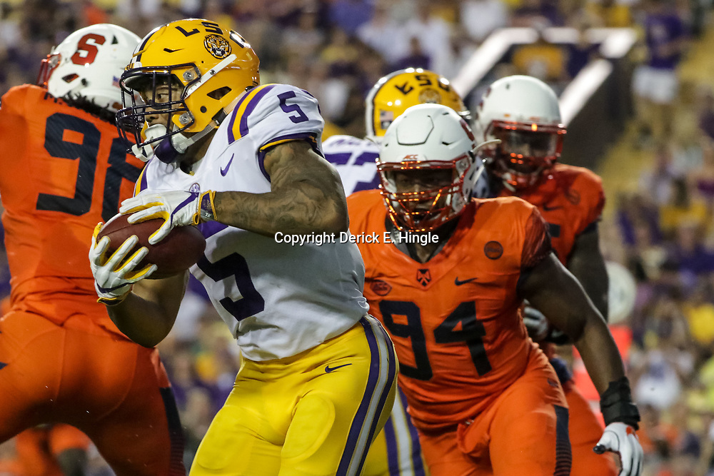 Sep 23, 2017; Baton Rouge, LA, USA; LSU Tigers running back Derrius Guice (5) runs past Syracuse Orange defensive lineman Alton Robinson (94) during the second quarter of a game at Tiger Stadium. Mandatory Credit: Derick E. Hingle-USA TODAY Sports
