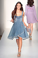 A Model walks the runway wearing Caravan Spring 2010 during Mercedes-Benz Fashion Week in New York, NY on September 11, 2009