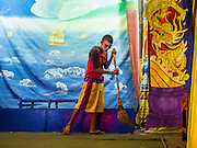16 JANUARY 2015 - BANGKOK, THAILAND:   A performed with the Sai Yong Hong Opera Troupe sweeps the stage at the Chaomae Thapthim Shrine, a Chinese shrine in a working class neighborhood of Bangkok near the Chulalongkorn University campus. The Lao Buan Heng Nee Teochew Opera Troupe has nine night performance at the shrine is an annual tradition and is the start of the Lunar New Year celebrations in the neighborhood. Lunar New Year, also called Chinese New Year, is officially February 19 this year. Teochew opera is a form of Chinese opera that is popular in Thailand and Malaysia.   PHOTO BY JACK KURTZ