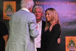 "Richard Gere and his girlfriend 20/2017-Pisa-Italy actor actor American actor Richard Gere in Italy for the launch of his film ""The Incredible Life of Norman"", which is in competition for the Oscar, is in Pisa for the symposium of ""The Mindscience of Reality"" with his girlfriend Alejandra Silva at the Palazzo dei Congressi seems to be bored. In Photos: By Richard Richard Gere embraces girlfriend Alejandra Silva. Photos RobertoCappa photojournalism."