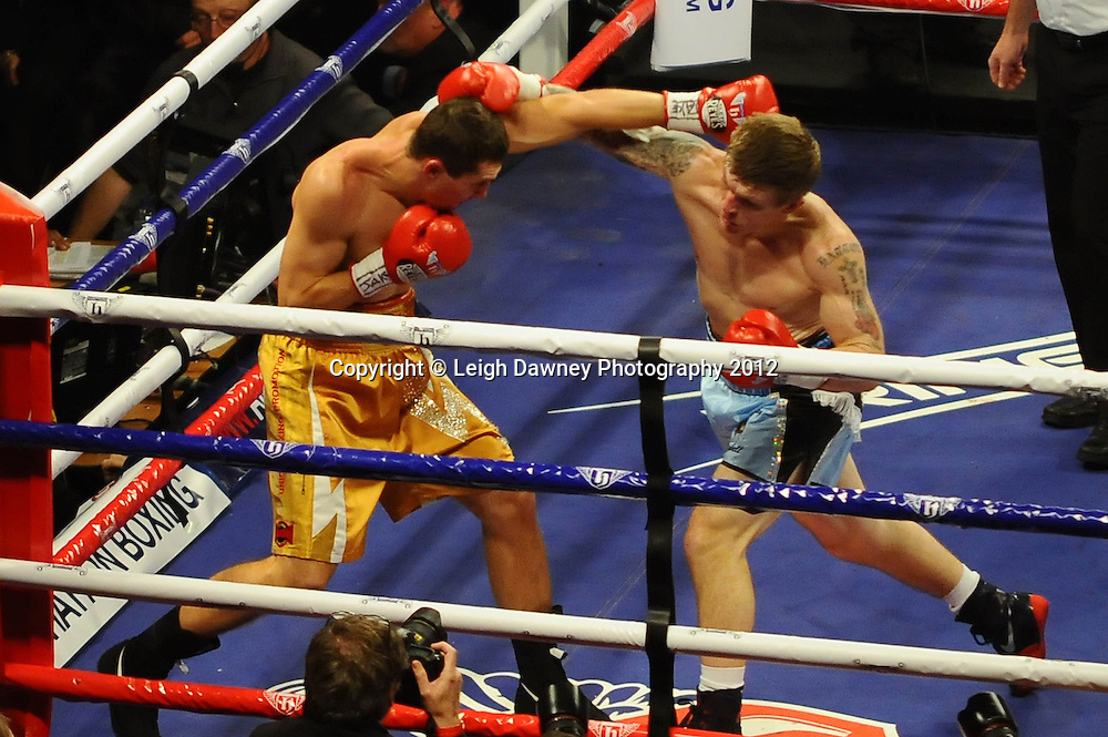 Vyacheslav Senchenko exchanges blows with Ricky Hatton during a 10x3 Welterweight fight. Manchester Evening News Arena, Manchester on the 24th November 2012. Hatton Promotions. Pictures by Photographer Leigh Dawney of © Leigh Dawney Photography 2012.