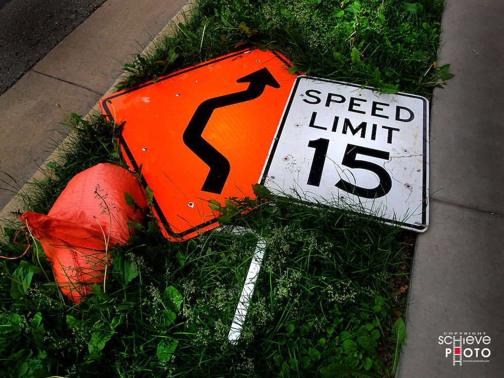 It seems as though these traffic signs might be more effective if they were stood upright.