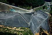 Mountain top removal coal mines in Blair County, West Virginia. The Spruce Mountain Laurel coal complex, part of arch coal. The big flats are refuse from the mining process.