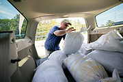 Tybee Island resident Cliff Kevill fills the back of his station wagon with sandbags from the city volleyball courts, Friday, Sept., 8, 2017, before Hurricane Irma is forecast to hit early next week.  (Stephen B. Morton for The Atlanta Journal Constitution)