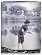 woman bathing by river early 1900s glass plate