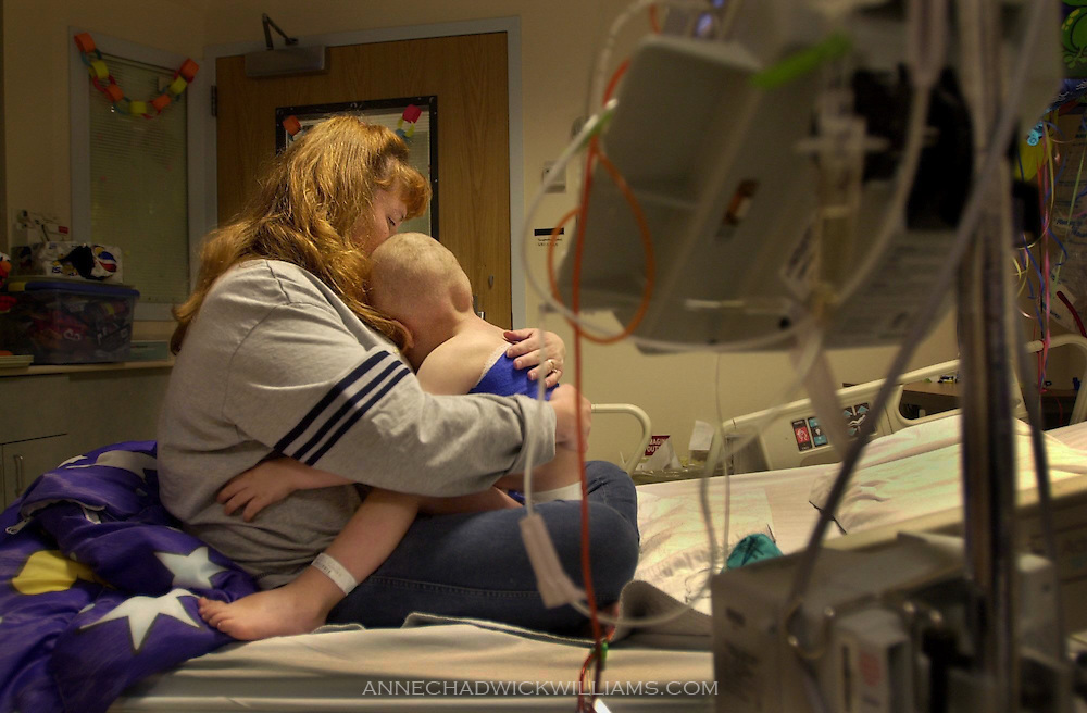 Alicia Bennett of Ione, CA comforts her son, Tommy, in his hospital room at Duke University Medical Center four days after his umbilical cord blood transplant. November 26, 2002