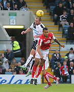 Dundee's James McPake out jumps Rotherham United's Jonson Clarke-Harris - Dundee v Rotherham United - pre-season friendly at Dens Park <br /> <br />  - &copy; David Young - www.davidyoungphoto.co.uk - email: davidyoungphoto@gmail.com