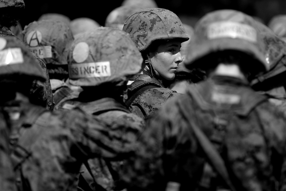 With her basic training nearly complete, Elaine Neal falls in line with the rest of her platoon as they stand in formation on Parris Island in South Carolina on Sept. 28, 2009. Greg Kahn/Staff