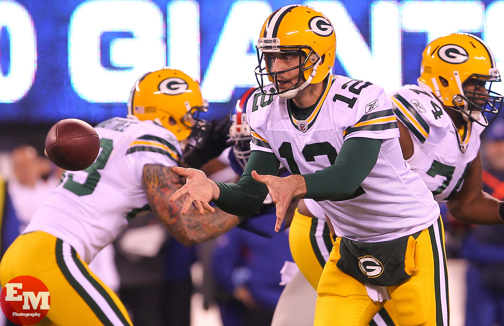 Dec 4, 2011; East Rutherford, NJ, USA; Green Bay Packers quarterback Aaron Rodgers (12) pitches the ball during the first half at MetLife Stadium.