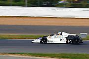 Car No 19 heads around Abbey. Silverstone Classic - 66-85 F1- 25/7/10.