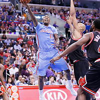 24 November 2013: Los Angeles Clippers shooting guard Jamal Crawford (11) goes for the layup past Chicago Bulls power forward Taj Gibson (22) during the Los Angeles Clippers 121-82 victory over the Chicago Bulls at the Staples Center, Los Angeles, California, USA.
