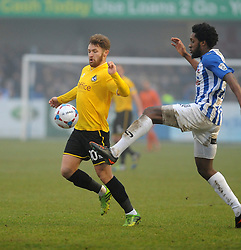 Bristol Rovers' Matty Taylor is challenged by Nuneaton Town's Anton Brown - Photo mandatory by-line: Neil Brookman/JMP - Mobile: 07966 386802 - 04/01/2015 - SPORT - football - Nuneaton - James Parnell Stadium - Nuneaton Town v Bristol Rovers - Vanarama Conference