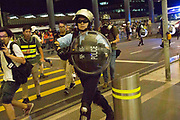 CHINA, Hong Kong: 13 August 2019 <br /> Demonstrators clash with riot police at Hong Kong International Airport. Demonstrators have taken to the streets of Hong Kong in protest of a controversial extradition bill since 9th of June which has resulted in several violent clashes.<br /> Rick Findler / Story Picture Agency