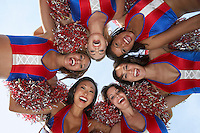 Cheerleaders in a Huddle