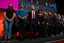 © Licensed to London News Pictures. 26/09/2018. Liverpool, UK. Labour Party Leader Jeremy Corbyn MP (3-L) joins the Liverpool People's Choir to sing the Red Flag at the end of the Labour Party Conference. Photo credit: Rob Pinney/LNP