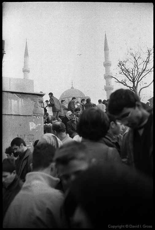 Crowds leave an underground passage in the Eminunu neighborhood of Istanbul, Turkey.
