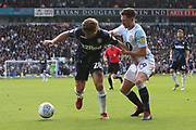 Leeds United defender Gaetano Berardi (28) holds off Blackburn Rovers midfielder Corry Evans (29) during the EFL Sky Bet Championship match between Blackburn Rovers and Leeds United at Ewood Park, Blackburn, England on 20 October 2018.