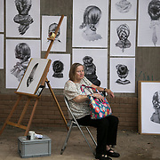 A tired visitor rest by art work by Nettie Wakefield. On the first day the show is open only a thousand locals who won free ticket gets an advanced entry to the show.Dismaland, a bemusement park set up by artist Banksy show casing more hand 40 artists. The bemusement park is set in a former lido in Weston Super-Mare.After much secrecy the show opened to a small number of locals from Weston Super-Mare Friday and fully to the public Saturday Aug 22.