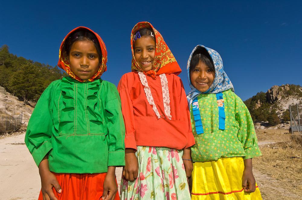 Tarahumara Indian girls wearing their colorful native costumes, Ejido San Alonso, Copper Canyon, Mexico