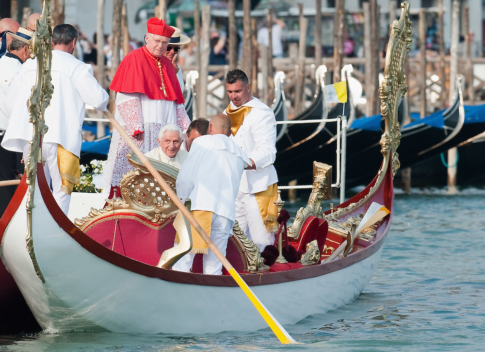 VENICE, ITALY - MAY 08:  Gondoliers help Pope Benedict XVI to board the Dogaressa gondola in St. Mark's basin on May 8, 2011 in Venice, Italy. Pope Benedict XVI is visiting Venice, some 26 years after predecessor Pope John Paul II last visited city.  (Photo by Marco Secchi/Getty Images)