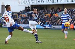 Millwall's DJ Cambell forces a good save from Reading's Alex McCarthy with this early shot - Photo mandatory by-line: Robin White/JMP - Tel: Mobile: 07966 386802 01/02/2014 - SPORT - FOOTBALL - The Den - Millwall - Millwall v Reading - Sky Bet Championship