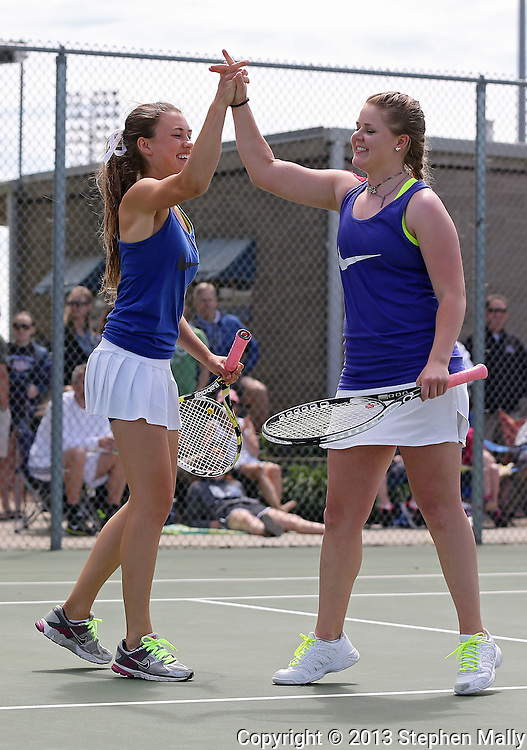 Urbandale's Michelle Van Roekel (from left) and Madeline Heer high five after a score during a doubles match in the Class 2A state team tennis tournament at Veterans Memorial Tennis Center in Cedar Rapids on Saturday, June 1, 2013.
