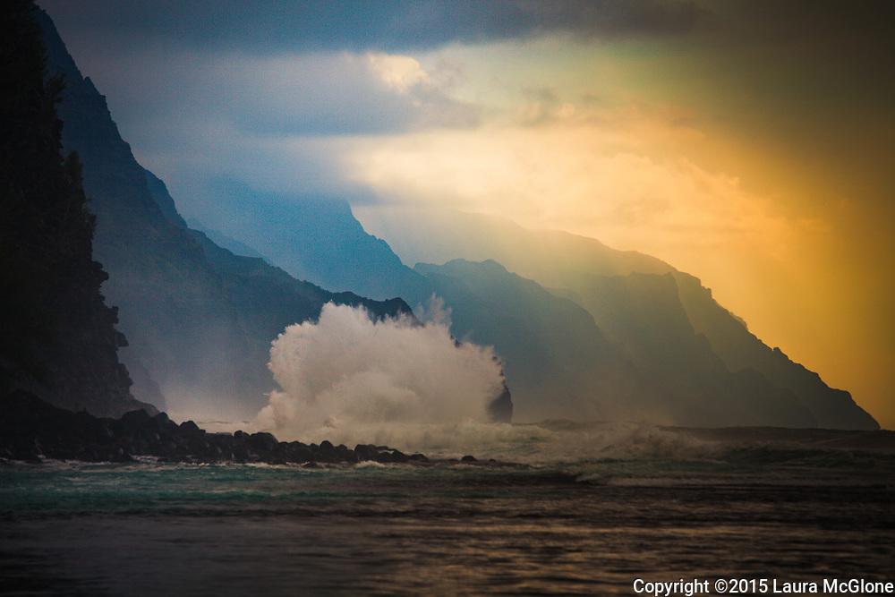 Hawaii Kauai Napali Coast Sunset with huge wave and mountains