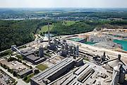 Nederland, Limburg, Gemeente Maastricht, 27-05-2013; Mergelgroeve Sint Pietersberg voor de winning van mergel (eigenlijk kalksteen) in dagbouw door cementfabriek ENCI. Maastricht aan de horizon. Wat er nog resteert van de St.Pietersberg, rond de groeve, is beschermd natuurgebied en bovengronds en ondergronds aangewezen als beschermd Habitatrichtlijngebied. <br /> Daarachter Sint-Pieterberg met bossen gezien in de richting Belgie. In de achtergrond  in het dal ligt het Belgische dorp Kanne, het water is het Albertkanaal. <br /> Marl quarry for the extraction of marl (limestone actually) in surface mining by cement factory ENCI. Maastricht at the horizon. What is left of the Sint-Pietersberg is designated as protected area, both on groundlvel and underground the habitat directives apply.<br /> Left the Sint Pietersberg, in the back the Belgian village Kanne, and Albertkanaal in Belgium. <br /> luchtfoto (toeslag op standaardtarieven);<br /> aerial photo (additional fee required);<br /> copyright foto/photo Siebe Swart.