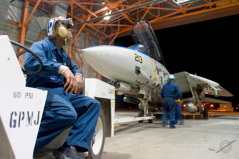 VF-213's retro-painted F-14D is rolled into the hangar at NAS Fallon for some electrical work.  Workups at Fallon provide the Airwing's aircrew to experience maintenance training at remote locations.