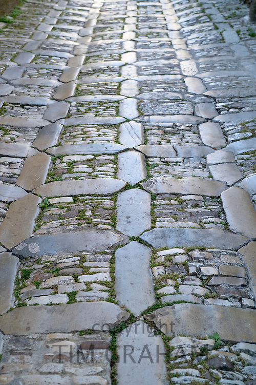 Patterns on the ground in pastel colours in cobble stones alleyway in Erice, Sicily, Italy